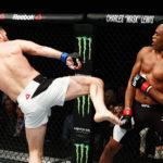 M. Bisping (esq) e A. Silva (dir) lutaram no ano passado (FOTO: Getty Images