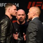 GSP (dir) encara M. Bisping (esq) (FOTO: Josh Hedges/UFC)