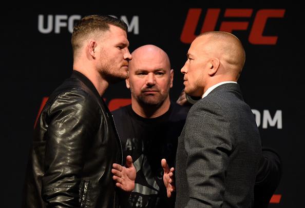 M. Bisping e GSP se encaram (FOTO: Josh Hedges/UFC)