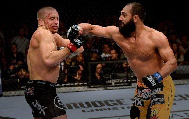Hendricks (dir) foi derrotado por St. Pierre (esq) em 2013 (Foto: Getty Images)
