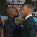 Mayweather (esq) e McGregor (dir): última encarada (Foto: Reprodução Youtube ufc)