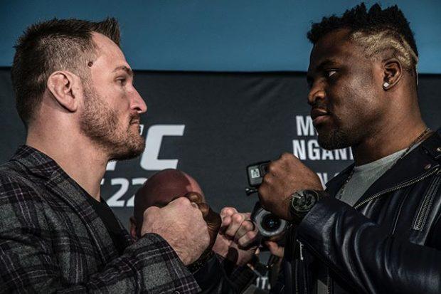 S. Miocic (esq) pega F. Ngannou (dir) no UFC 220 (Foto: Reprodução Instagram ufc_brasil)
