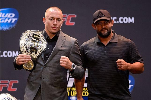 Hendricks (dir.) já enfrentou St.Pierre (esq.) em 2013. Foto: Josh Hedges/UFC