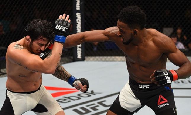 E. Silva (esq.) foi derrotado por N. Magny (dir.). Foto: Jeff Bottari/UFC