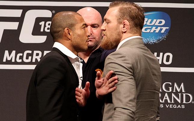 Aldo (esq.) x McGregor (dir.) encabeçará UFC 194. Foto: Josh Hedges/UFC