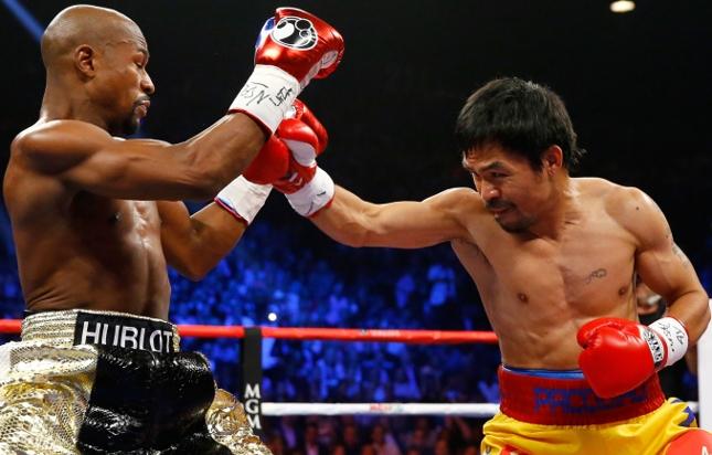 Pacquiao (dir.) e Mayweather (esq.) se enfrentaram em 2/5. Foto: Getty Images