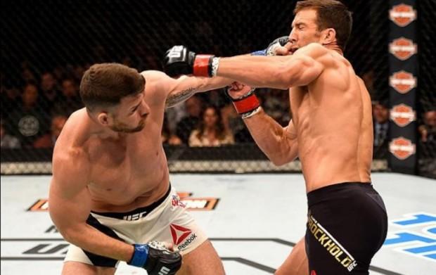 Rockhold (dir.) foi nocauteado por Bisping (esq.). Foto: Josh Hedges/UFC