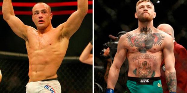 Alvarez (esq.) defende o cinturão dos leves contra McGregor (dir.) no UFC 205 em NY