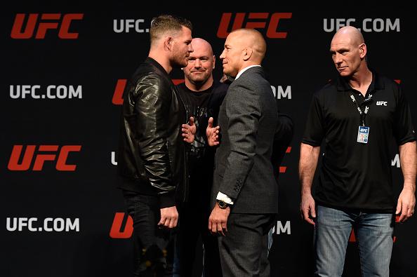 M. Bisping (esq) enfrentará GSP (dir) (FOTO: Josh Hedges/UFC)