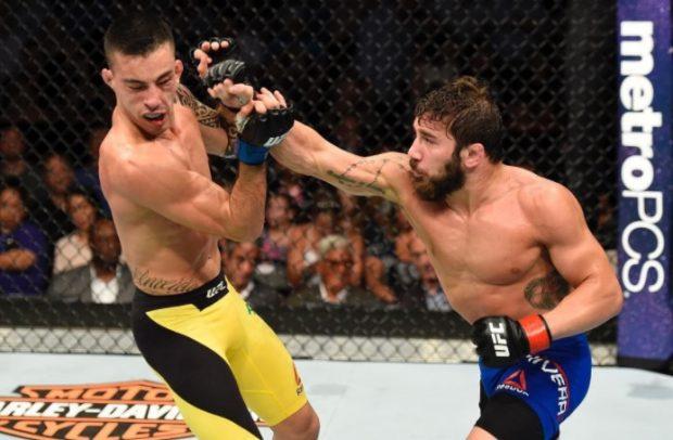 Almeida (esq) perdeu a segunda no UFC (Foto: Reprodução Instagram ufc)