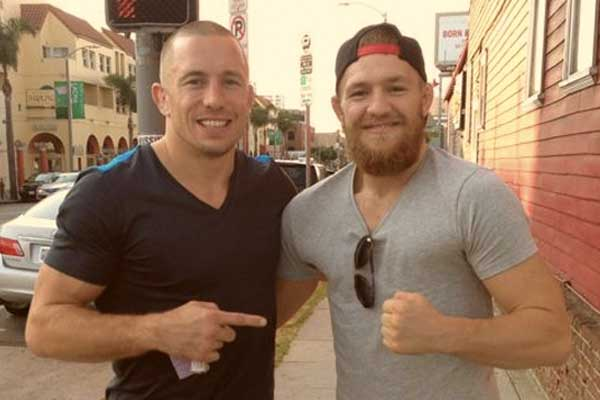 GSP (esq) e McGregor (dir) em 2013 (Foto: Reprodução Twitter GeorgesStPierre)